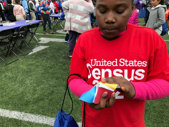 "Daziah Joshua, 10, participates in math activities at the Liberty Bowl. Statistics in Schools, an educational program within the United States Census Bureau, launched in 2020 national programming in Memphis. More than 1,000 fifth graders filed into the Liberty Bowl Oct. 28 to participate in statistics activities inspired by the program's classroom curriculum.  Steven Dillingham, the director of the Census Bureau, spoke to the students, as well as Shelby County Schools superintendent Joris Ray. David Osmond of children's show ""Wonderama"" hosted Monday's program."