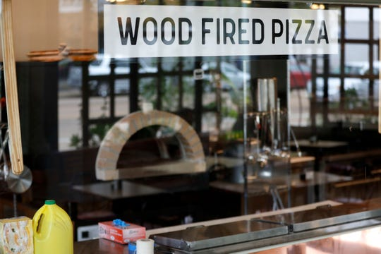 A wood-fired pizza oven can be seen from the dining room Monday, Oct. 28, 2019, at Tamboli's Pasta & Pizza in Memphis.