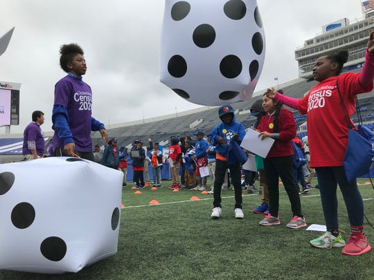 """Daziah Joshua, 10, participates in math activities at the Liberty Bowl. Statistics in Schools, an educational program within the United States Census Bureau, launched in 2020 national programming in Memphis. More than 1,000 fifth graders filed into the Liberty Bowl Oct. 28 to participate in statistics activities inspired by the program's classroom curriculum.  Steven Dillingham, the director of the Census Bureau, spoke to the students, as well as Shelby County Schools superintendent Joris Ray. David Osmond of children's show """"Wonderama"""" hosted Monday's program."""