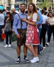 Lederhosen and dirndl dresses are everywhere during Munich's Oktoberfest.