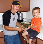 Michael Edward Bell with his 5-year-old brother Carson in September 2004, two months before Bell was shot and killed by Kenosha police. Carson is now 15.