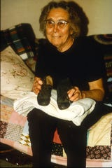 Titanic survivor Louise Kink Pope shows the shoes she wore, and the blanket she had with her when she was rescued at age 4. Pope died in 1992.