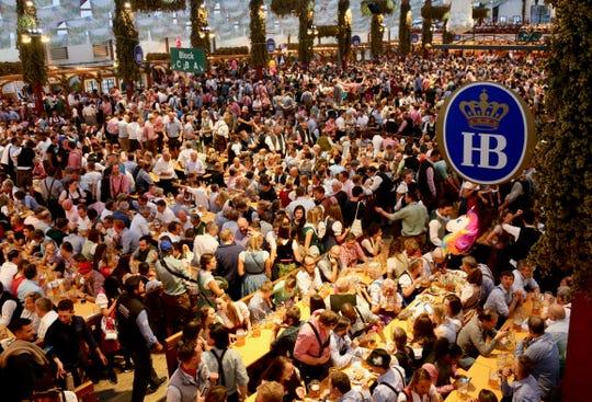 Mammoth crowds fill the Oktoberfest halls.