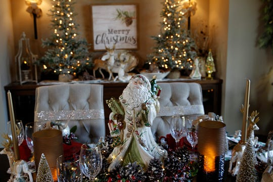 A large Santa surrounded by pine cones adorns the dining room table.