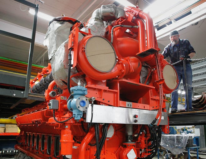 Randy Stretlow works on the final assembly of a gas engine at what was then GE's Waukesha gas engines plant in January 2014.