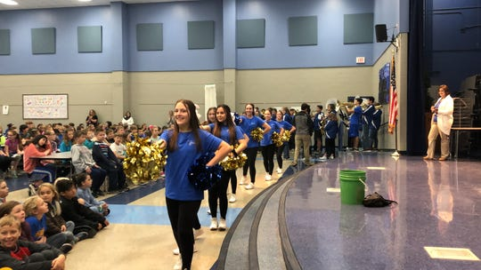 Members of the Mountain Home Junior High cheerleading squad participate in a drug-free rally held last week at Hackerl Intermediate school as part of National Red Ribbon Week.