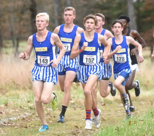 Mountain Home's Whit Lawrence (left) won the 5A-East Conference individual championship on Monday at Mountain Home High School. Also pictured during the race are: (from left) Bob Allen, Andrew Westphal, Jacob Pyeatt and Ky Bickford.
