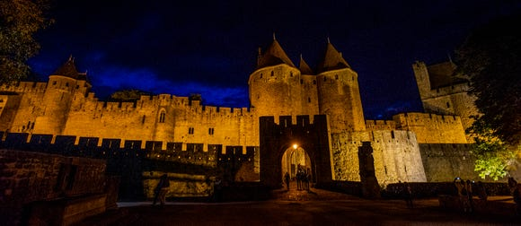 The gates of Carcassonne at nightfall.