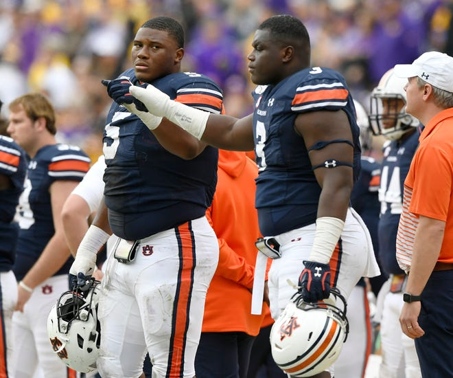 Auburn defensive linemen Derrick Brown (5) and Marlon Davidson (3) on the sidelines together during a loss at LSU on Saturday, Oct. 26, 2019 in Baton Rouge, LA