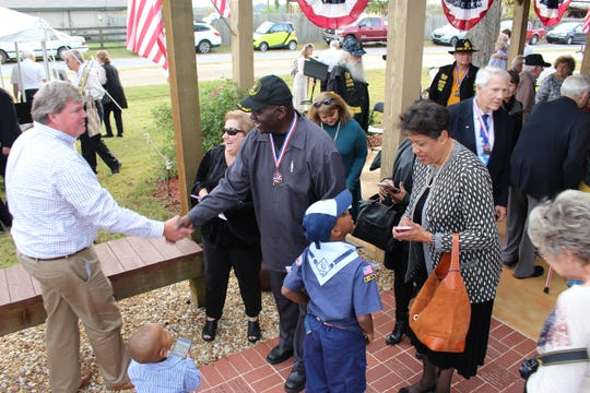 After a ceremony honoring veterans, families review the hundreds of bricks placed in the Veterans Memorial Walk of Honor in Pike Road.
