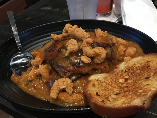Catfish atchafalaya is served at a preview event Friday at Walk-On's Bistreaux & Bar in Montgomery.