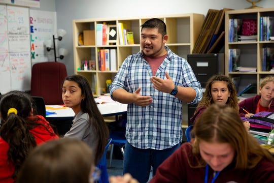 Richard Luong, talks with his seventh-grade English language arts class, Monday, Oct. 28, 2019, at Gulf Coast Charter Academy South in East Naples. Luong was awarded the 2019-2020 Teacher of Distinction for Gulf Coast Charter Academy by Champions For Learning.