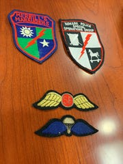 Patches displayed by Newark police retired Sgt. Rich Mason, who was instrumental in the formation of the agency's Special Operations Group in 1989, show the patches were based on Merrill's Marauders, a SOG that fought during World War II. Newark police SOG's patch (upper right) shows a Trojan horse, which represents tactics, the Roman Centurion weapons and shield represent weapons, and the thunderbolt indicated a strike force. Newark police's SOG marked its 30th anniversary in 2019.
