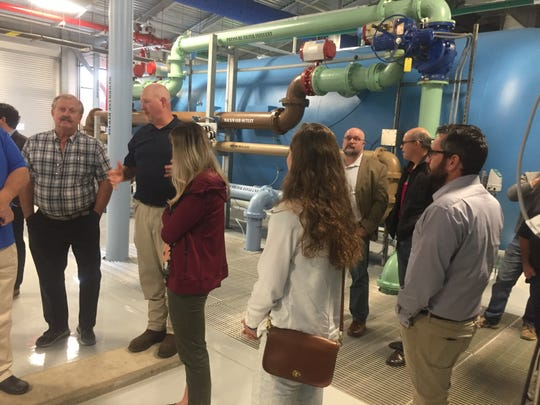 Chad Sims, water treatment supervisor, (second from left) conducts Friday's tour of the new York Road water treatment facility.