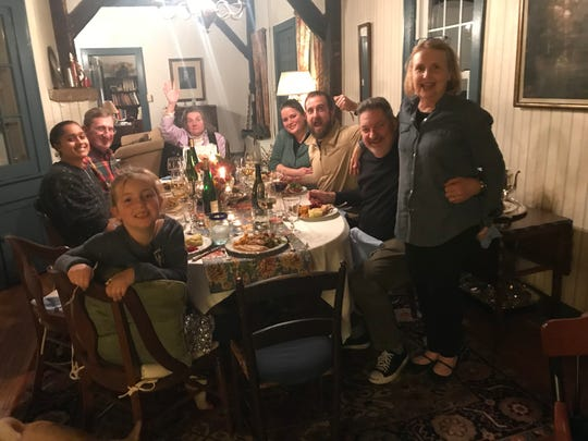Liz Johnson's family and friends at the Thanksgiving table in 2018, the year they decided to always serve oysters.