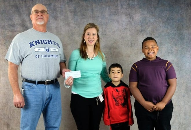 The Knights of Columbus, St. Joseph Council 4256, recently made a donation of $500 to Mesilla Valley Christian School in Las Cruces in support of its annual Serve-A-Thon event. The Knights wanted to acknowledge the work being done at the school and its interdenominational curriculum. Pictured from left are John Zunich Knights of Columbus; Kristina Lozano director of development, MVCS;Elijah Lozano andZahmyrr Kelley.