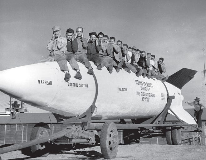 General Electric employees posing on the V-2 rocket. GE had the contract to work on the V-2 at the Proving Ground.
