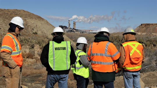 New Energy Economy Executive Director Mariel Nanasi, center, asks questions while inspecting an arroyo, Monday, Oct. 28, 2019, near the San Juan Generating Station.