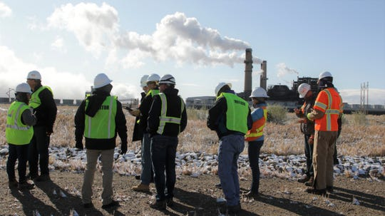 Members of New Energy Economy, and its expert, tour San Juan Generating Station with the Public Service Company of New Mexico and its experts, Monday, Oct. 28, 2019, in Waterflow.