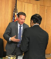 United States Representative Michael Cloud (R-TX-27) talking to a panelist after the event.