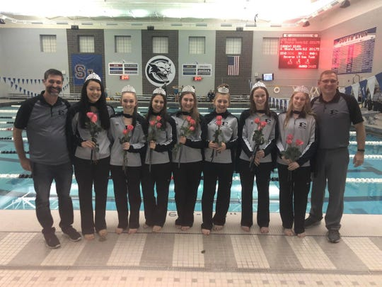 South Lyon East diving coach Kevin Ferguson, Hannah Sun, Alyssa Mayer, Melanie Cosens, Lindsay Boals, Sophia Ohland, Lindsey Filhart, Allison Engberg and swim coach John Burch celebrate senior night.