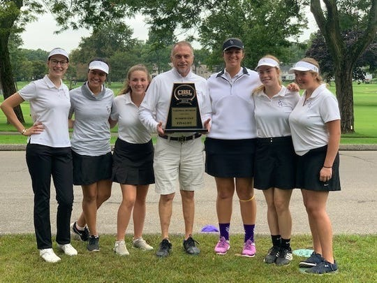 The St. Catherine golf team poses with its trophy after qualifying for the state competition.