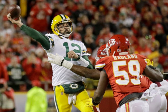 Green Bay Packers quarterback Aaron Rodgers (12) throws a pass under pressure from Kansas City Chiefs linebacker Reggie Ragland (59) during the first half of an NFL football game in Kansas City, Mo., Sunday, Oct. 27, 2019.