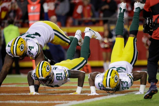 Green Bay Packers running back Aaron Jones (33) celebrates with wide receiver Geronimo Allison (81) and offensive guard Elgton Jenkins (74) in the Kansas City Chiefs end zone after what he thought was a touchdown, during the first half of an NFL football game in Kansas City, Mo., Sunday, Oct. 27, 2019. The play was called back due to a holding penalty.