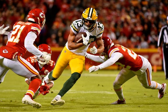 Green Bay Packers wide receiver Allen Lazard (13) carries the ball against Kansas City Chiefs cornerback Bashaud Breeland (21), safety Tyrann Mathieu (32) and safety Juan Thornhill (22), during the second half of an NFL football game in Kansas City, Mo., Sunday, Oct. 27, 2019.