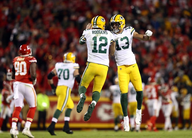 Quarterback Aaron Rodgers #12 and wide receiver Allen Lazard #13 of the Green Bay Packers celebrate after a touchdown during the game against the Kansas City Chiefs at Arrowhead Stadium on October 27, 2019 in Kansas City, Missouri.