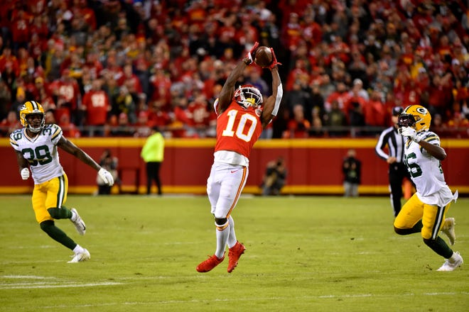 Kansas City Chiefs wide receiver Tyreek Hill (10) makes a catch between Green Bay Packers cornerback Chandon Sullivan (39) and safety Darnell Savage (26) during the first half of an NFL football game in Kansas City, Mo., Sunday, Oct. 27, 2019.