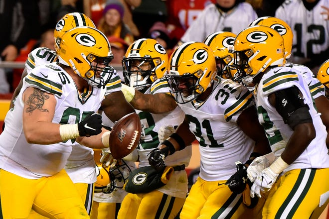 Green Bay Packers players celebrate with defensive lineman Tyler Lancaster (95), who recovered a ball fumbled by Kansas City Chiefs running back LeSean McCoy, during the second half of an NFL football game in Kansas City, Mo., Sunday, Oct. 27, 2019.