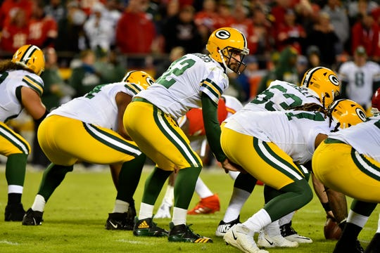 Green Bay Packers quarterback Aaron Rodgers (12) waits for the snap at the line of scrimmage, during the first half of an NFL football game against the Kansas City Chiefs in Kansas City, Mo., Sunday, Oct. 27, 2019.