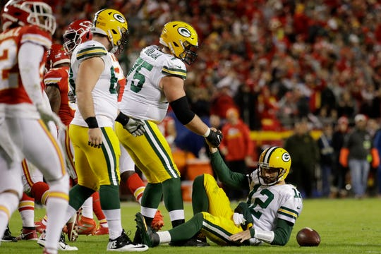 Green Bay Packers quarterback Aaron Rodgers (12) is helped up after he was sacked by Kansas City Chiefs defensive end Emmanuel Ogbah, during the second half of an NFL football game in Kansas City, Mo., Sunday, Oct. 27, 2019.