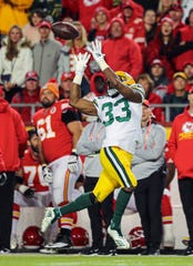 Green Bay Packers running back Aaron Jones (33) catches a pass against the Kansas City Chiefs during the first half at Arrowhead Stadium.