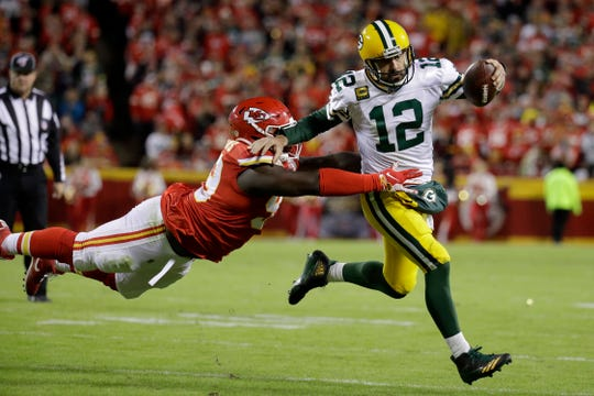 Green Bay Packers quarterback Aaron Rodgers (12) is tackled by Kansas City Chiefs defensive tackle Khalen Saunders (99) during the second half of an NFL football game against the Kansas City Chiefs in Kansas City, Mo., Sunday, Oct. 27, 2019.