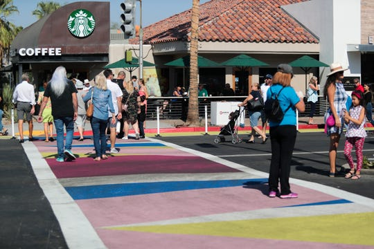 Crowds walk in the painted crosswalks in the El Paseo shopping district on Sunday, October 27, 2019 in Palm Desert, Calif.