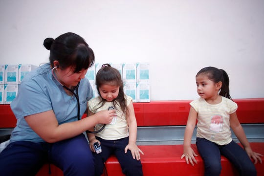 Madelyn Valdez, 4, is diagnosed by Dr. Kacie Paik of UCR Family Health Center during a free health screening given at Desert Mirage High School on October 28, 2019.