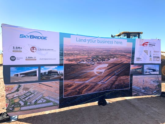 A poster of SkyBridge's planned developments on display at the groundbreaking ceremony.