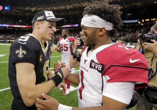New Orleans Saints quarterback Drew Brees (9) talks with Arizona Cardinals quarterback Kyler Murray (1) after a win at the Mercedes-Benz Superdome.