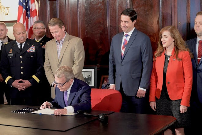 Gov. Mike DeWine signs a bill sponsored by Senator Theresa Gavarone, who represents the 2nd District in the Ohio Senate.