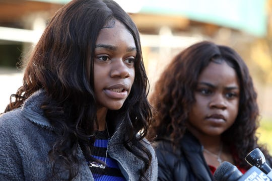 Jamelia Barnett, 16, of Poughkeepsie speaks as her sister Julissa Dawkins, 13, looks on at White Plains Federal Court Oct. 28, 2019.  Their mother, Melissa Johnson, is suing the city for false arrest of her daughters and the use of excessive force.