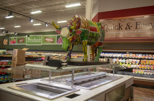 The Karns cow, commissioned for the 2004 Cow Parade in Harrisburg, was brought in to stand guard over the salad bar at the new store in Newberry Township.