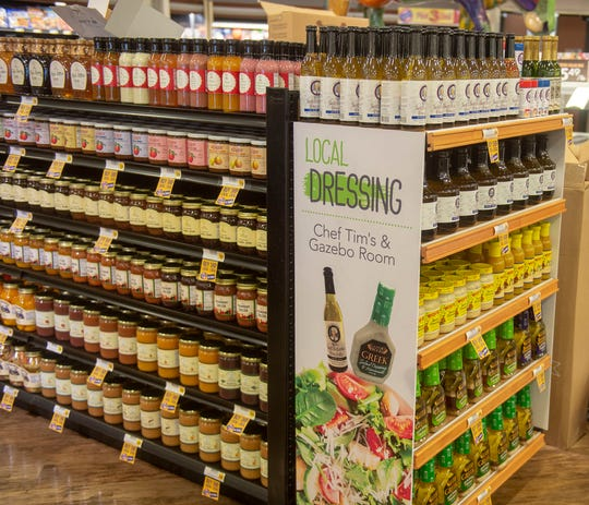 Local products are prominently featured in the produce section just inside the front door of the new Karns Quality Foods store in Newberry Township.