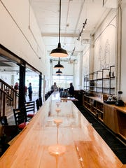 A 48-foot birch bar commands the front room at the new Ferino Distillery on East Fourth Street in Reno.