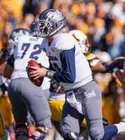 Nevada Wolf Pack quarterback Carson Strong (12) runs against the Wyoming Cowboys during the second quarter at Jonah Field War Memorial Stadium.