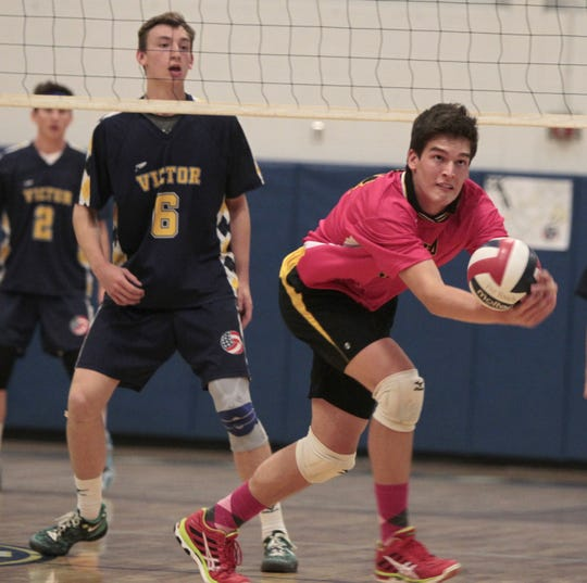 McQuaid's Dane Leclair chases down a save during a match at Victor.