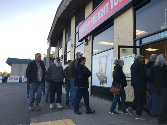 Customers enter Harbor Freight Tools in Redding soon after the store opened on Monday, Oct. 28, 2019. Dozens of customers lined up in front of the store before sunrise to buy a generator.