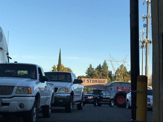 Traffic backs up in the parking lot of Harbor Freight Tools on Monday, Oct. 28. 2019. After buying a generator, customers had to get in their vehicle and pick it up at the back of the store.