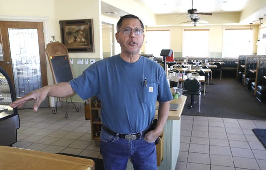 Vittles Family Restaurant owner Joe Martinez stands inside his empty restaurant on Monday, Oct. 28, 2019, as he gets ready to reopen after PG&E turned  back on the power in Anderson.